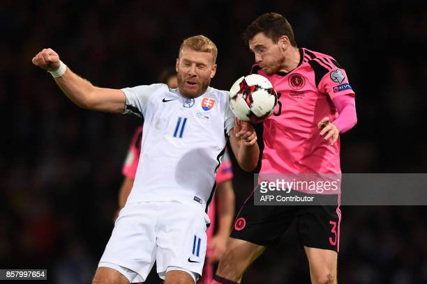 Slovakia's striker Adam Nemec vies with Scotland's defender Andrew Robertson during the FIFA World Cup 2018 qualifying football match between...