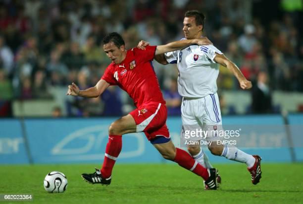 Slovakia's Szilard Nemeth and Czech Republic's Tomas Galasek battle for the ball
