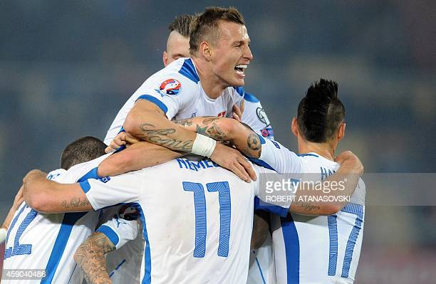 Slovakia's team celebrate their victory during the UEFA Euro 2016 qualifying football match between Macedonia and Slovakia at the Filip II stadium in...