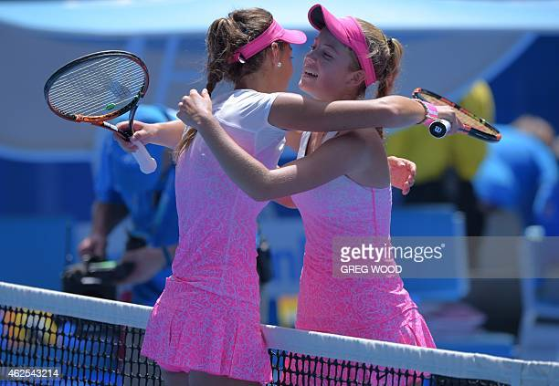 Slovakia's Tereza Mihalikova embraces as she celebrates after victory in her junior girl's singles final match against Britain's Katie Swan on day...