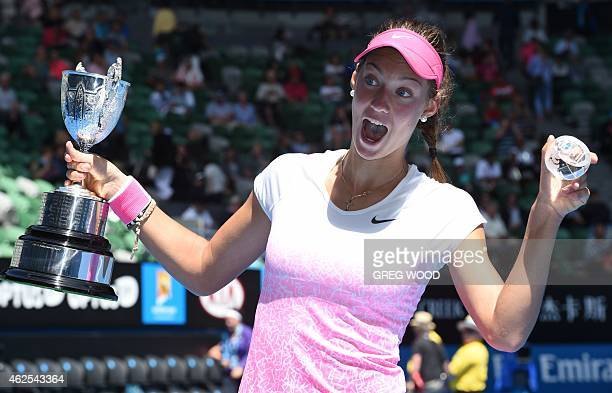 Slovakia's Tereza Mihalikova poses with the trophy as she celebrates after victory in her junior girl's singles final match against Britain's Katie...