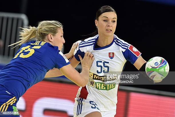 Slovakia's Tetyana Trehubova vies with Sweden's Johanna Ahlm during the Main Round Group 2 match Sweden vs Slovakia of the 2014 Women's European...