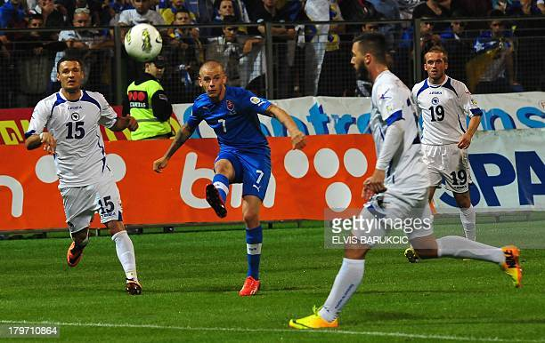 Slovakia's Vladimir Weiss shoots for goal while Bosnia and Herzegovina's Sejad Salihovic and Haris Medunjanin atempt to block the ball during a...
