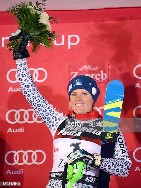 Slovakia's winner Veronika Velez Zuzulova celebrate on the podium after the FIS alpine women's slalom competition on Sljeme mountain above the...