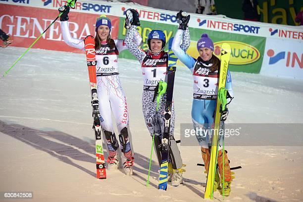 Slovakia's winner Veronika Velez Zuzulova Slovakia's second placed Petra Vlhova and third placed Czech Sarka Strachova celebrate on the finish line...