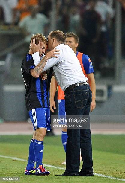 Slovan Bratislava's midfielder Peter Stepanovsky celebrates with Slovan Bratislava's coach Vladimír Weiss after scoring against AS Roma during their...