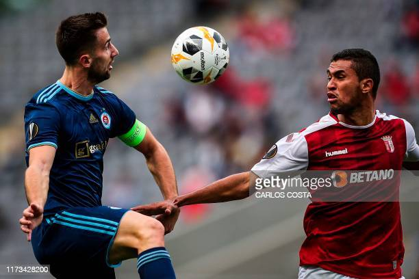 Slovan Bratislava's Slovenian forward Andraz Sporar vies with Sporting Braga's Brazilian defender Pablo Santos during the UEFA Europa League Group K...