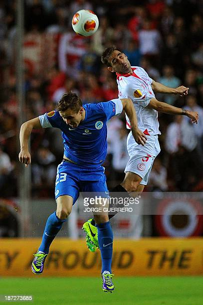 Slovan Liberec's Czech forward Josef Sural vies with Sevilla's defender Fernando Navarro during the UEFA Europa League football match Sevilla FC vs...
