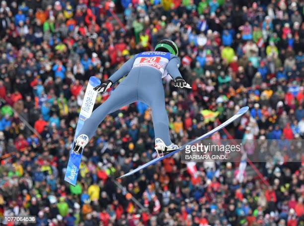 Slovania's Timi Zajc jumps during the third stage of the FourHills Ski Jumping tournament in Innsbruck Austria on January 4 2019 The third...
