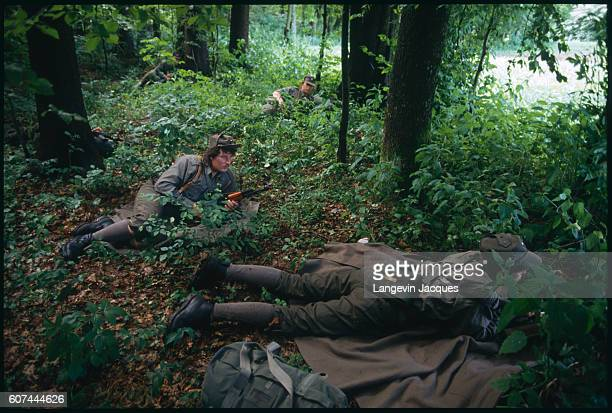 Slovene soldiers hide in a forest as the territorial army is deployed around Ljubljana airport in order to control aerial access following Slovenia's...