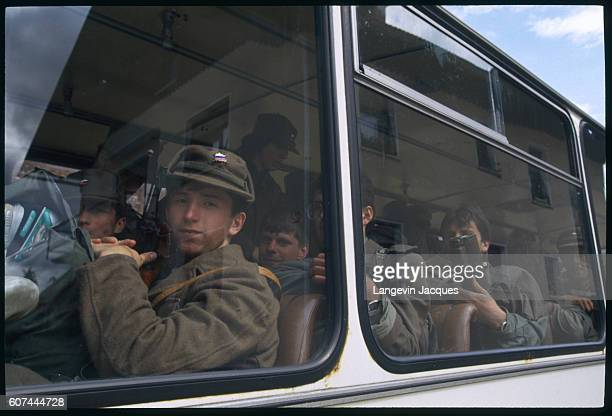 Slovene soldiers on board a bus join the rest of the territorial army positioned around Ljubljana airport in order to control aerial access following...
