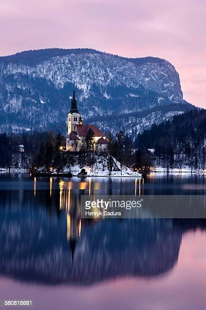 Slovenia, Bled, Lake Bled and illuminated Church of the Assumption
