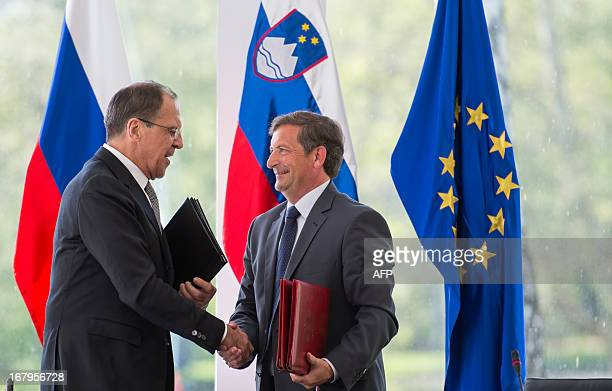 Slovenia Foreign Minister Karl Erjavec and his Russian counterpart Sergei Lavrov shake hands after signing a bilateral agreement during a meeting in...