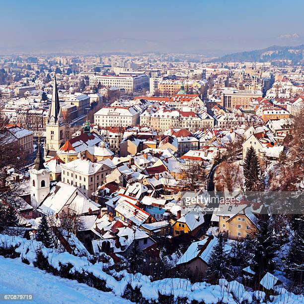 slovenia, ljubljana, snowy city at sunset - ljubljana stock pictures, royalty-free photos & images
