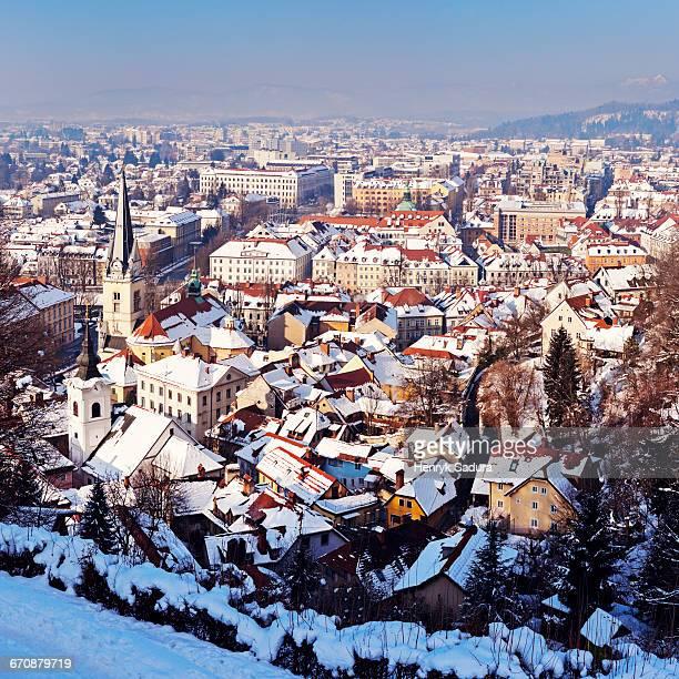 Slovenia, Ljubljana, Snowy city at sunset
