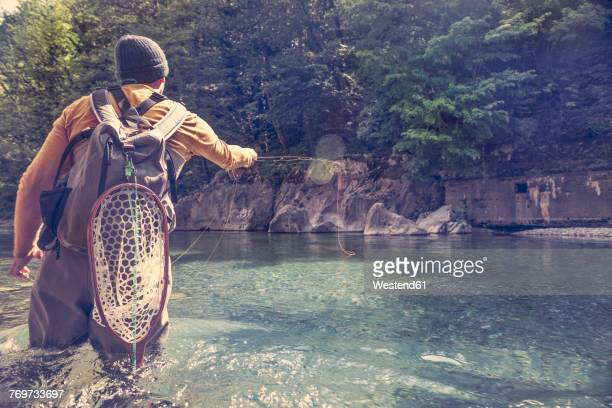 Slovenia, man fly fishing in Soca river