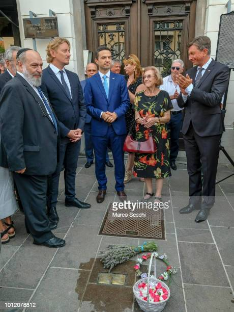 Slovenia Parliament Speaker Matej Tonin Auschwitz survivor Erika Furst and President of the Republic of Slovenia Borut Pahor stand in front of the...