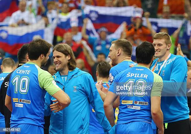 Slovenia team mates celebrate their win during the 24th Men's Handball World Championships Eighth Final EF1 match between Slovenia and Macedonia at...