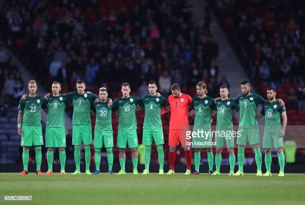 Slovenia team observe a minutes silence during the FIFA 2018 World Cup Qualifier between Scotland and Slovenia at Hampden Park on March 26 2017 in...