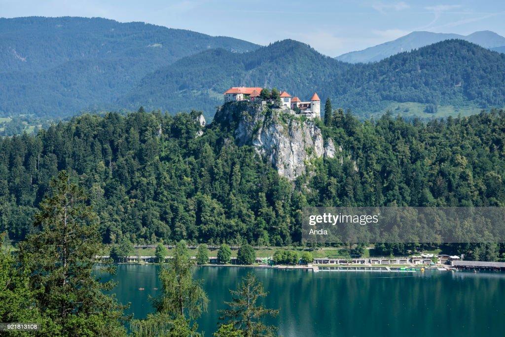Slovenia, Triglav National Park. Lake Bled (Blejsko jezero). Bled Castle set high up on a rocky peak.