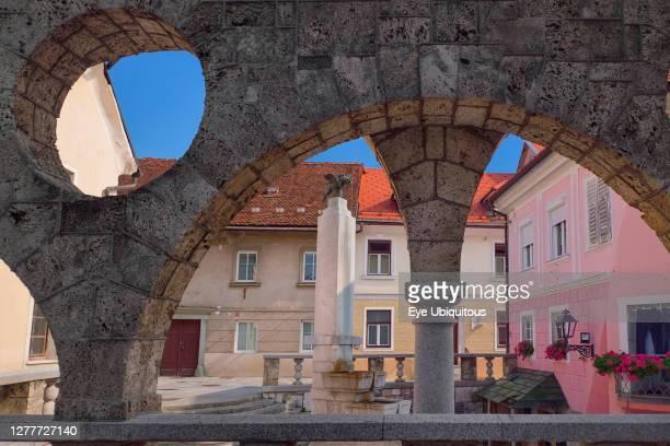 Slovenia, Upper Carniola, Kranj, Plecniks Arcade and fountain.