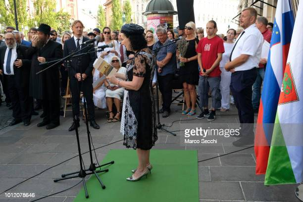 Slovenian actress Polona Vetrih and Robert Waltl of the Jewish Cultural Centre Ljubljanan take part in the ceremony of the Stumbling Stones on August...