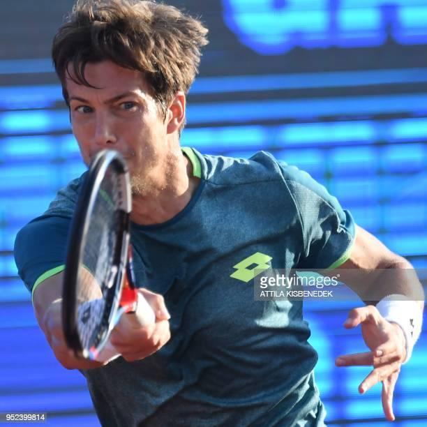 Slovenian Aljaz Bedene returns the ball to Australian John Millman during their ATP semifinal tennis match at the Hungarian Open in Budapest on April...