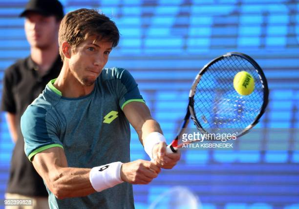 Slovenian Aljaz Bedene returns the ball to Australian John Millman during their ATP semifinal tennis match at the Hungarian Open in Budapest on April...