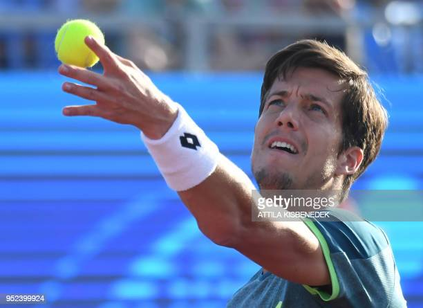 Slovenian Aljaz Bedene serves to Australian John Millman during their ATP semifinal tennis match at the Hungarian Open in Budapest on April 28 2018