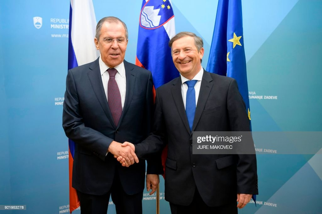 Slovenian Foreign Minister Karl Erjavec (R) welcomes and shakes hands with Russian Foreign Minister Sergei Lavrov (L) during their meeting in Ljubljana, on February 21, 2018. / AFP PHOTO / Jure Makovec