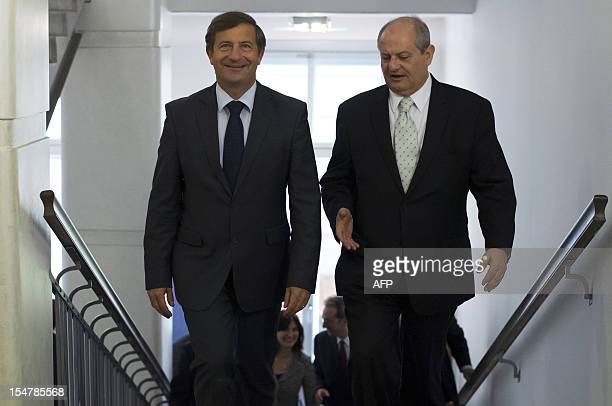 Slovenian Foreign Minister Karl Erjavec welcomes his Serbian counterpart Ivan Mrkic prior to a meeting in Ljubljana on October 26 2012 AFP PHOTO /...