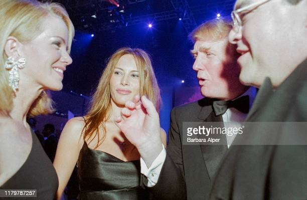 Slovenian former model Melania Knauss and her boyfriend , American real estate developer Donald Trump talk with unidentified others during the 18th...