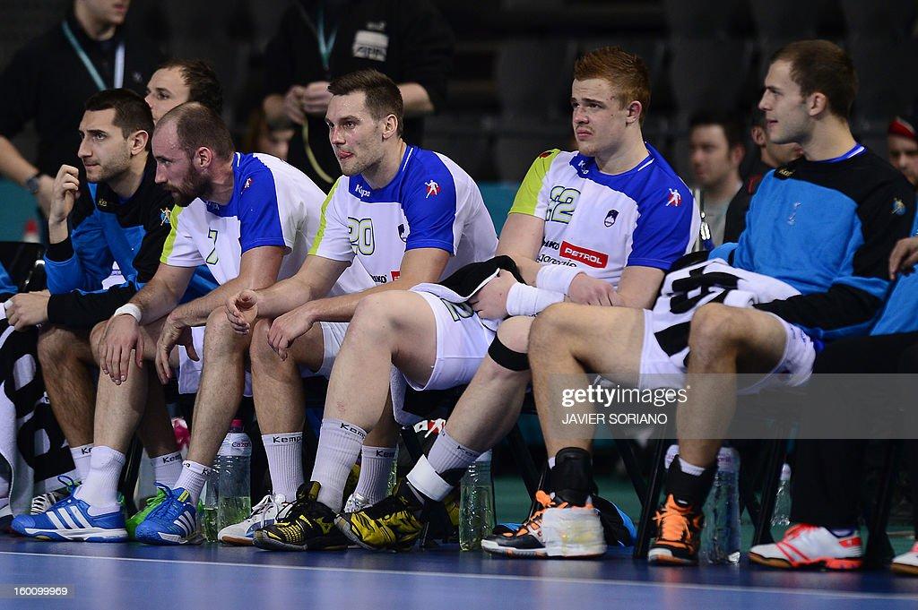 Slovenian handball players react during the 23rd Men's Handball World Championships bronze medal match Slovenia vs Croatia at the Palau Sant Jordi in Barcelona on January 26, 2013. Croatia won 31-26.