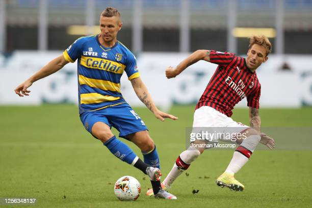 Slovenian midfielder Jasmin Kurtic of Parma Calcio and Argentinian midfielder Lucas Biglia of AC Milan during the Serie A match between AC Milan and...