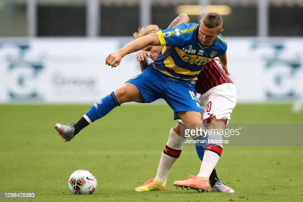 Slovenian midfielder Jasmin Kurtic of Parma Calcio controls the ball under pressure form Argentinian midfielder Lucas Biglia of AC Milan during the...