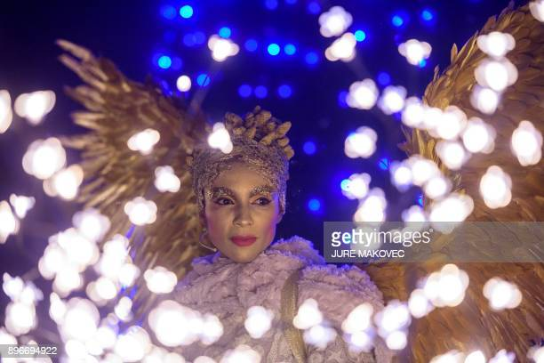 TOPSHOT Slovenian opera singer Irena Yebuah Tiran performs during a Live Nativity Scene in the Postojna Cave on December 21 2017 in Postojna The Live...