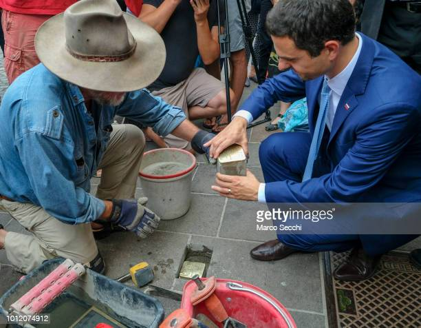 Slovenian Parliament Speaker Matej Tonin and German artist Gunter Demnig lay a block installation in the city center to remember the Slovenian Jews...