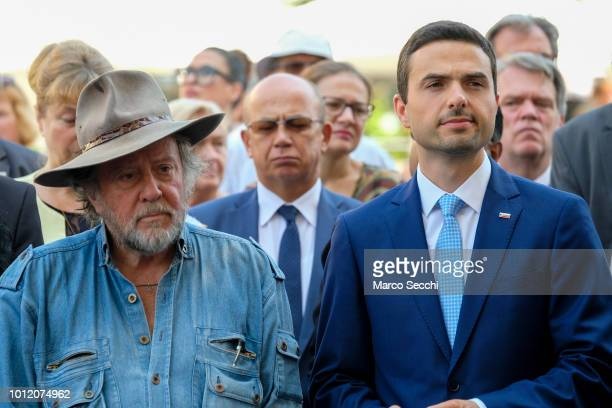 Slovenian Parliament Speaker Matej Tonin and German artist Gunter Demnig stand ahead of the laying the first Stumbling Stone on August 6 2018 in...