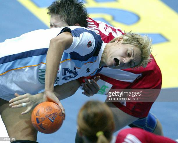 Slovenian player Ania Freser is fouled by her Romania opponenet Teodora Vartic on their match of 16th Women's World Championships 2003in Rijeka 10...