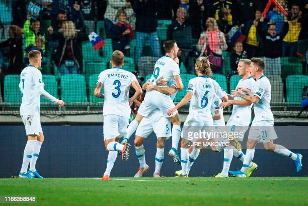 Slovenian players celebrate after scoring a goal during the Euro 2020 qualifying football match between Slovenia and Poland at the Stadium Stozice in...