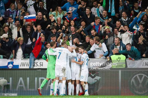 Slovenian players celebrate after scoring a goal during the Euro 2020 qualifying football match between Slovenia and Israel at the Stadium Stozice in...