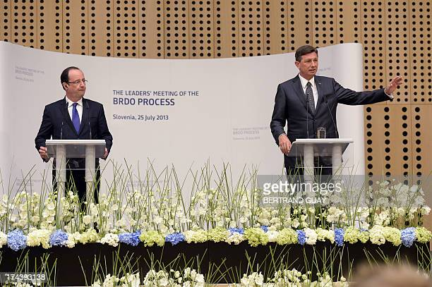 Slovenian President Borut Pahor and his French counterpart Francois Hollande speak during the Brdo Process leaders' meeting at Brdo Castle in Brdo...