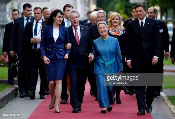 Slovenian President Borut Pahor and his wife Tnaja Pecar and Austrian President Heinz Fischer with wife Margit walking through Ljubljana Slovenia 24...