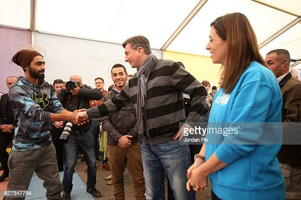 Slovenian President Borut Pahor meets staff at Makani's gym run by Unicef during his visit to the Zaatari refugee camp on December 3 2016 near Al...