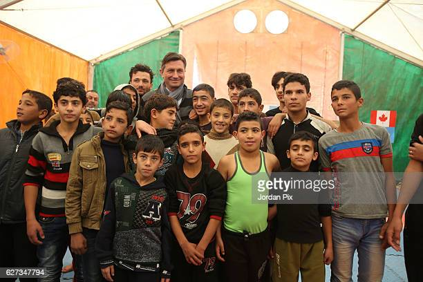 Slovenian President Borut Pahor meets Syrian refugee children during their exercise at Makani's gym run by Unicef during his visit to the Zaatari...
