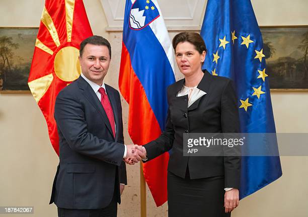 Slovenian Prime Minister Alenka Bratusek shakes hands with her Macedonian counterpart Nikola Gruevski during a meeting in Brdo near Kranj on November...