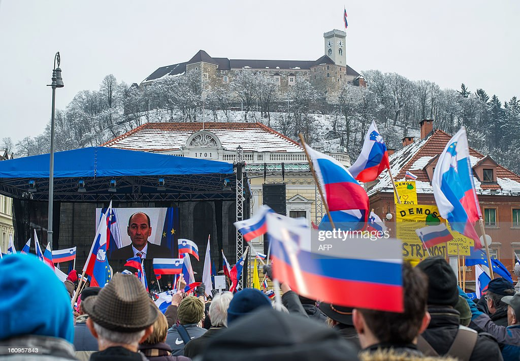 Slovenian prime minister Janez Jansa adresses the crowd through a videoconference during pro-government rally organised by the Assembly for the Republic, in support of Jansa on February 8, 2013 in Ljubljana's Congress Square. Slovenia's political crisis escalated on February 5 as a second partner left Prime Minister Janez Jansa's shaky coalition after he rejected the party's call to resign.