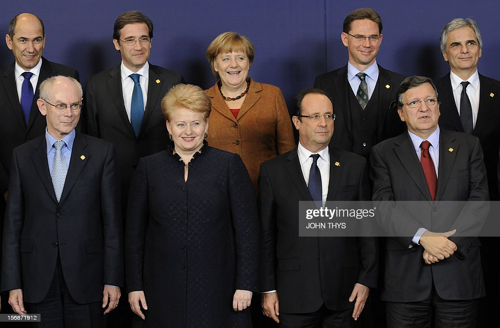 Slovenian Prime Minister Janez Jansa, European Council President Herman Van Rompuy, Portuguese Prime Minister Pedro Passos Coelho, Lithuanian President Dalia Grybauskaite, German Chancellor Angela Merkel, French President Francois Hollande, Finnish Prime Minister Jyrki Katainen, European Commission President Jose Manuel Barroso and Austrian Federal Chancellor Werner Faymann pose at the EU Headquarters on November 22, 2012 in Brussels, during a two-day European Union leaders summit called to agree a hotly-contested trillion-euro budget through 2020. European Union officials were scrambling to find an all but impossible compromise on the 2014-2020 budget that could successfully move richer nations looking for cutbacks closer to poorer ones who look to Brussels to prop up hard-hit industries and regions.