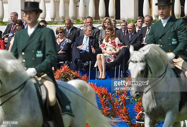 Slovenian Prime Minister Janez Jansa, his partner Urska Bacovnic, US President George W. Bush and US First Lady Laura Bush attend a Lipizzaner Horse...