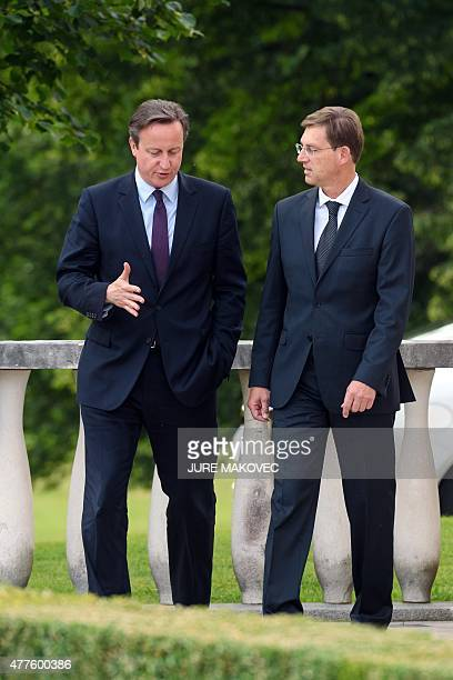 Slovenian Prime Minister Miro Cerar and British Prime Minister David Cameron talk during their meeting at Brdo Castle some 25 km north of Ljubljana...
